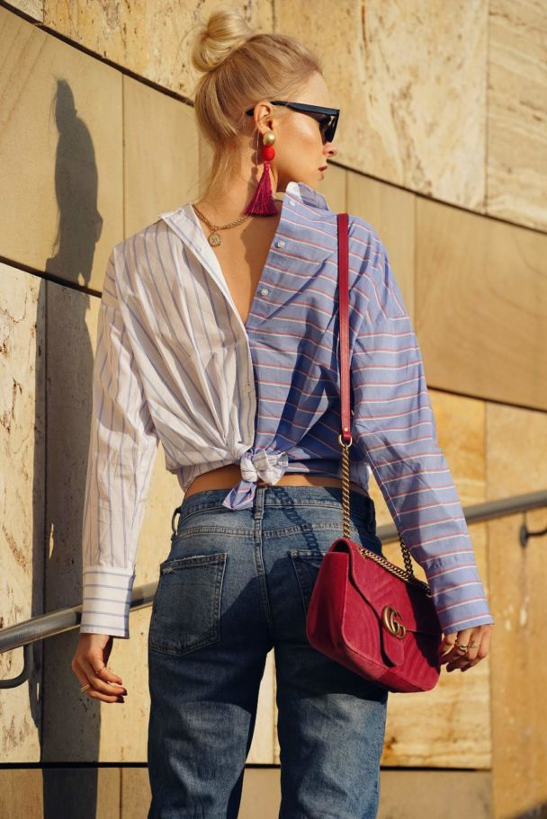 striped blouse with denim jeans and fringe earrings