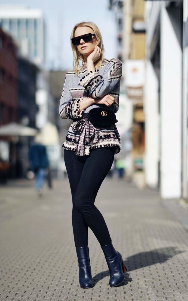 black stretch pants with blouse and shades